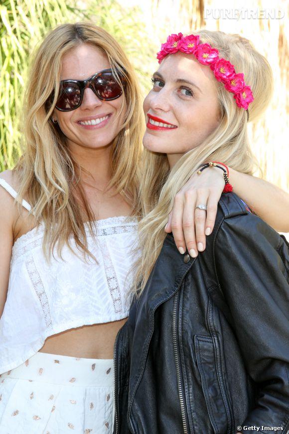 Sienna Miller et Poppy Delevingne lors du premier week-end de Coachella à Indio en avril 2014.