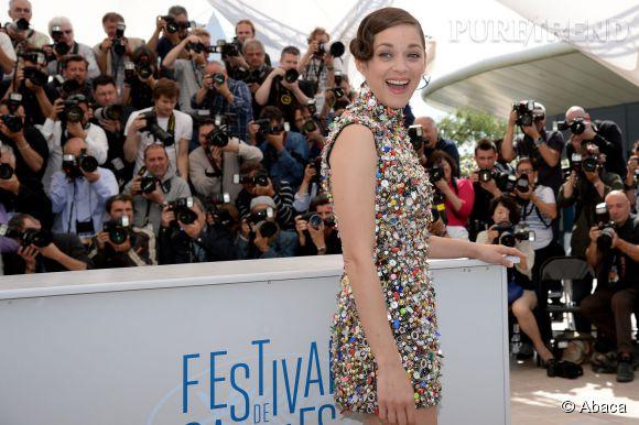 """Marion Cotillard lors du photcall pour """"Deux jours une nuit"""" des Frères Dardenne à Cannes le 20 mai 2014."""