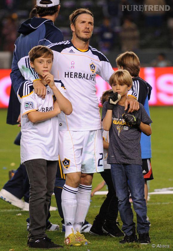 David Beckham et ses fils Brooklyn et Romeo en 2011.