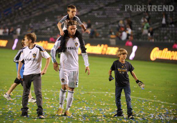 David Beckham et ses fils Brooklyn, Cruz et Romeo en 2011.