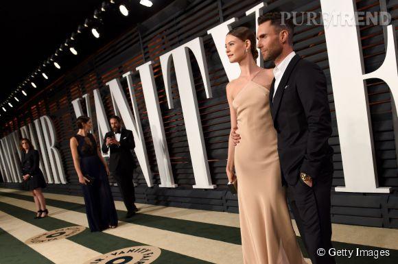 Behati Prinsloo en Calvin Klein et Adam Levine lors de la soirée post Oscars organisée par  Vanity Fair  le 22 février 2015 à Los Angeles.