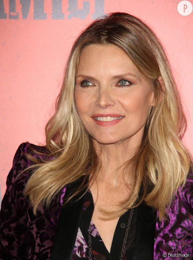 "Michelle Pfeiffer, souriante lors de la promo de ""Malavita"", de Luc Besson, en 2013."