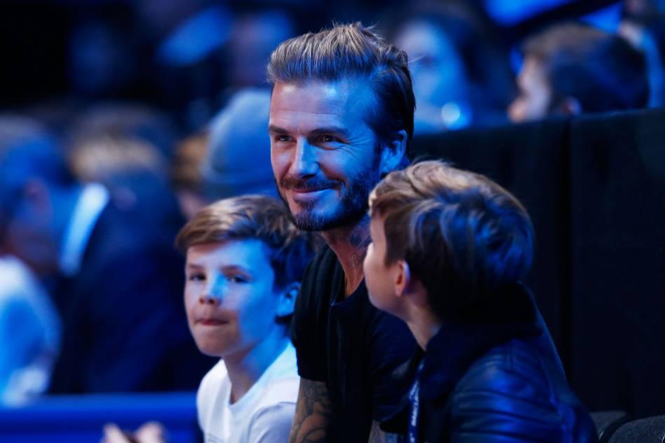 Avec Romeo et Cruz, David Beckham est un papa heureux.