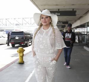 """La chanteuse voit en 2009 sa carrière musicale lancée grâce à la chanson """"Tik Tok""""."""