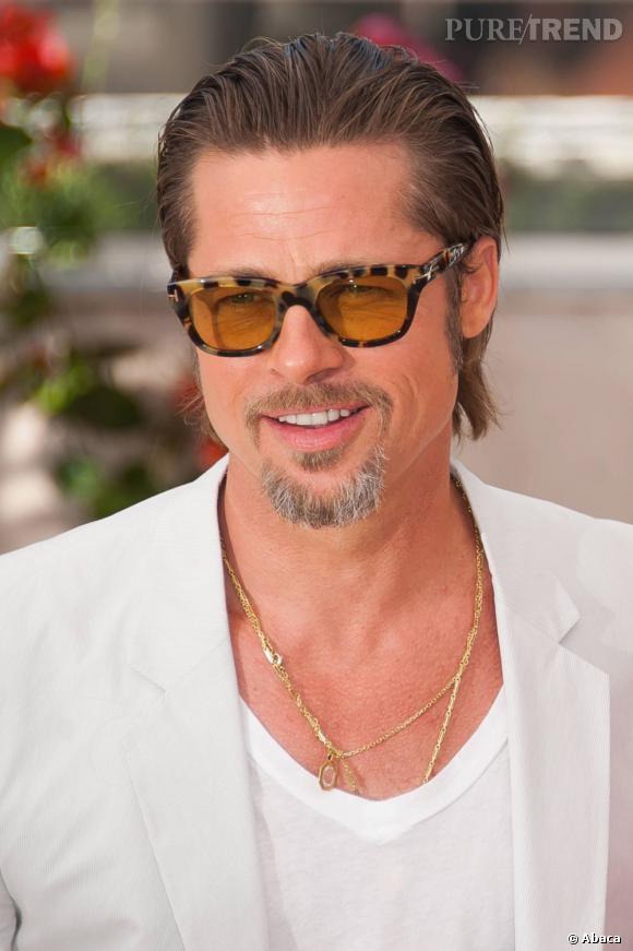Brad Pitt et sa chatoyante paire de Ray-Ban, disponibles au rayon femme de votre marchand favori.