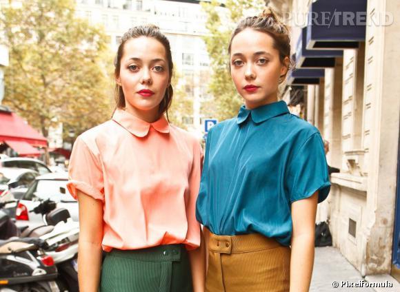 Des jumelles parfaitement identiques, tant sur le plan physique que stylistique, avec les mêmes blouses flashy à col Claudine.