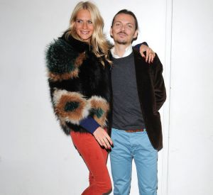 Poppy Delevingne au côté du styliste Matthew Williamson.