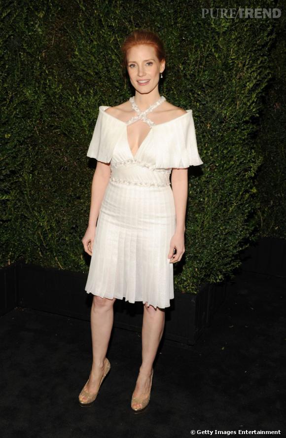 Jessica Chastain au dîner Chanel pré-Oscars 2013 à Los Angeles le 23 février. Elle porte une robe issue de la collection Printemps-Été 2013 couture Chanel.