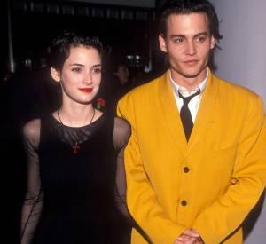 Au bras de Winona Ryder, Johnny Depp jour les Dick Tracy en chair et en os à la première de Cry-Baby en 1990.