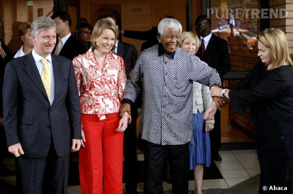 La Princesse Mathilde de Belgique et son mari le Prince Philippe de Belgique rencontrent Nelson Mandela en 2006.