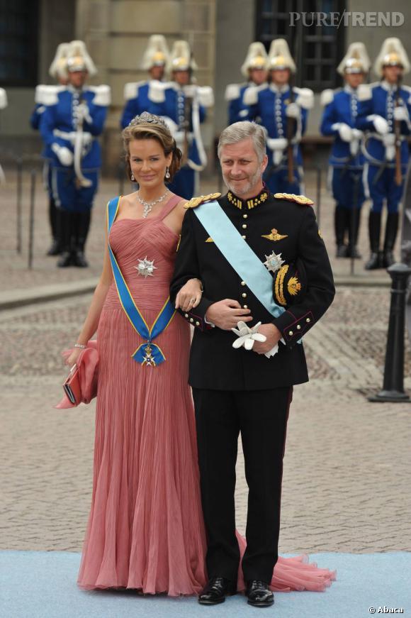 La Princesse Mathilde de Belgique et son mari le Prince Philippe de Belgique au mariage de Victoria de Suède.