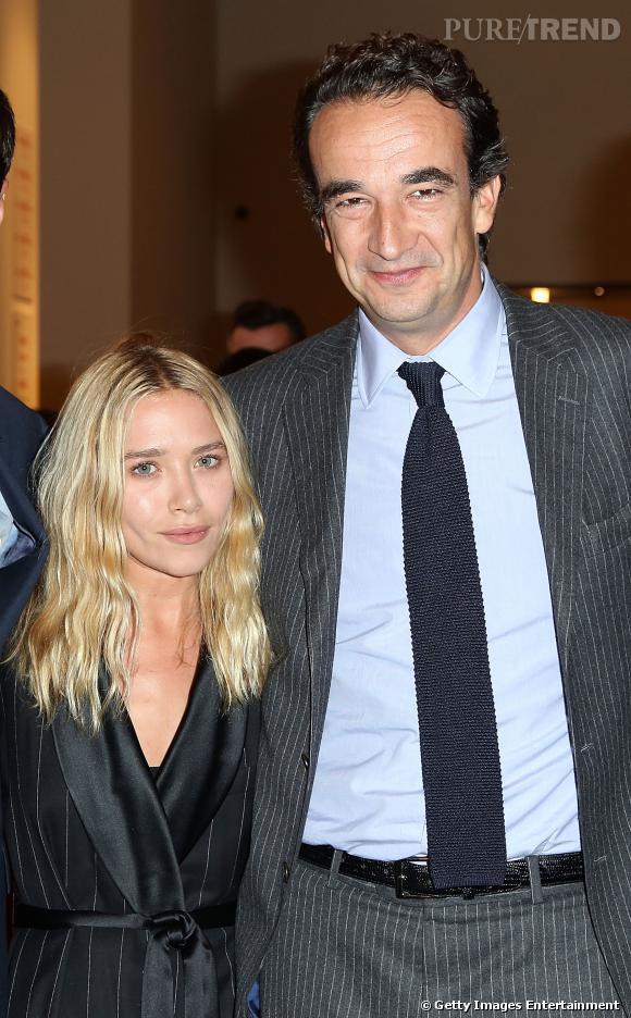 """Mary Kate Olsen et Olivier Sarkozy lors de la soirée de charité """"Take Home a nude"""" à New York."""