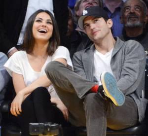 Mila Kunis et Ashton Kutcher : les paparazzis les font bien rire !
