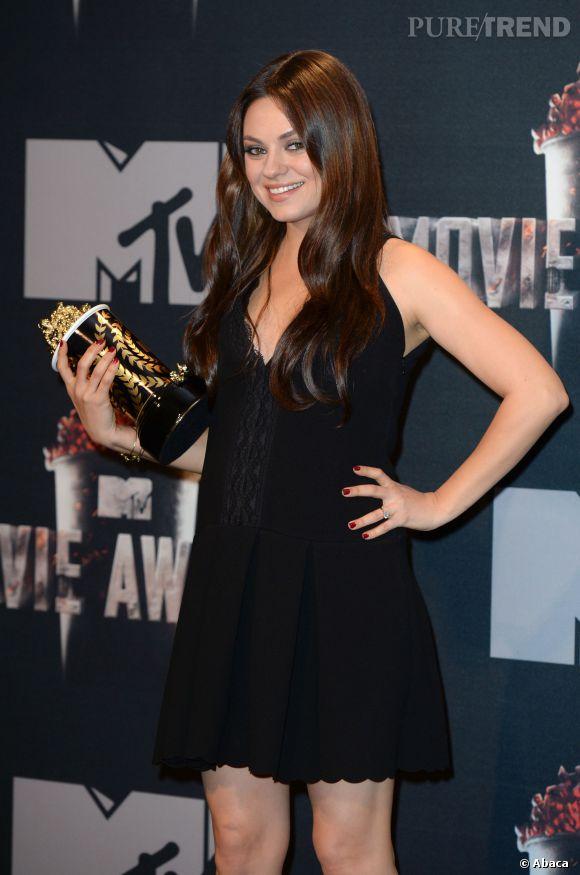 Mila Kunis a dévoilé ses premières rondeurs de future maman le 13 avril 2014 lors des MTV Movie Awards.