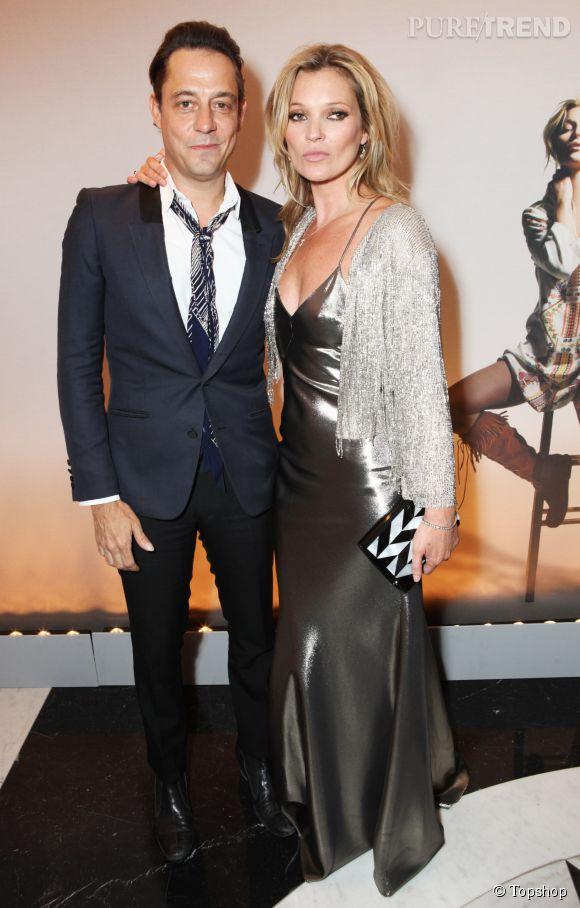 Kate Moss, incarnation même du glamour rétro dans une robe nuisette et une veste à franges de sa propre collection et Jamie Hince son mari et guitariste de The Kills.