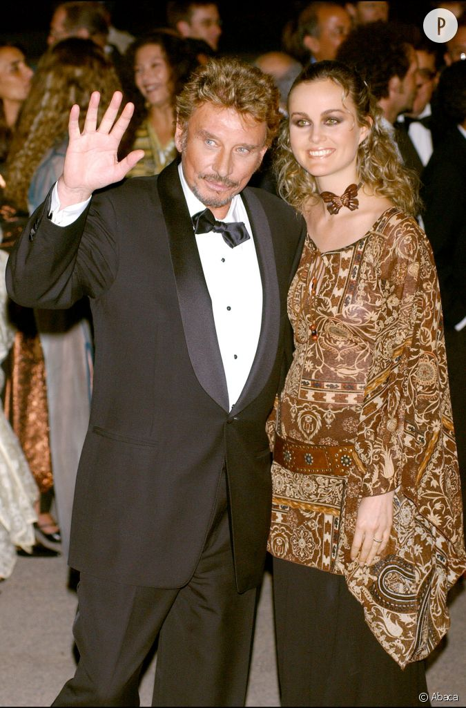 johnny et laeticia hallyday beaux et bronz s le 29 septembre 2002 au festival du film de. Black Bedroom Furniture Sets. Home Design Ideas