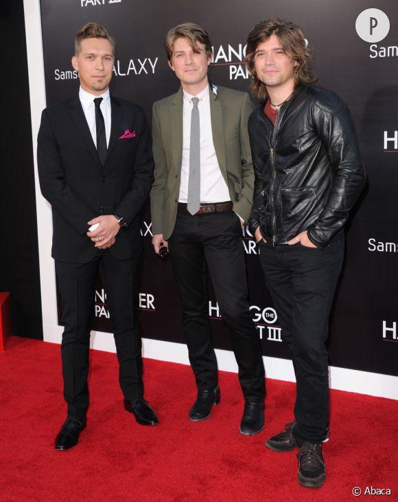 """Les Hanson ont bien changés depuis el succès de """"MMMBop"""". Ici, Isaac, Taylor et Zac en 2013."""