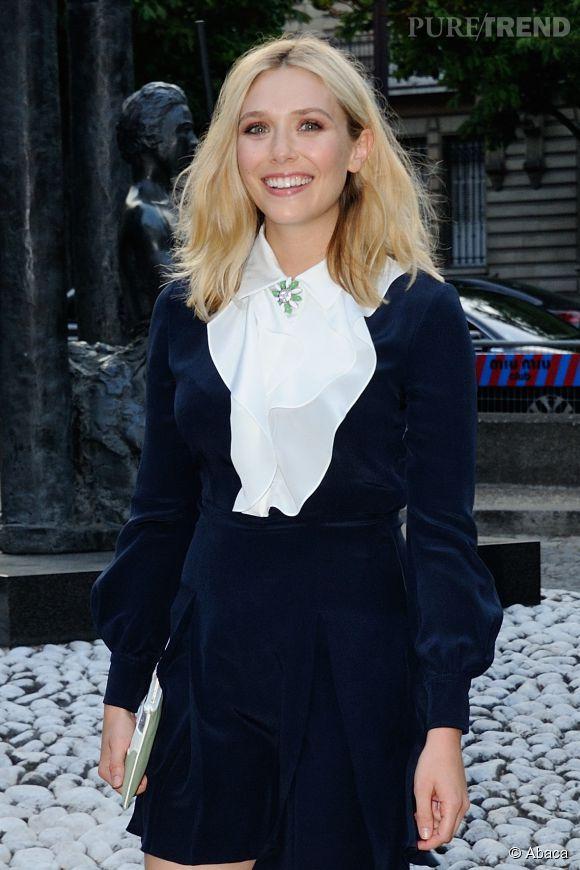 Elizabeth Olsen était de passage à Paris ce week-end pour la soirée de lancement du parfum Miu Miu.