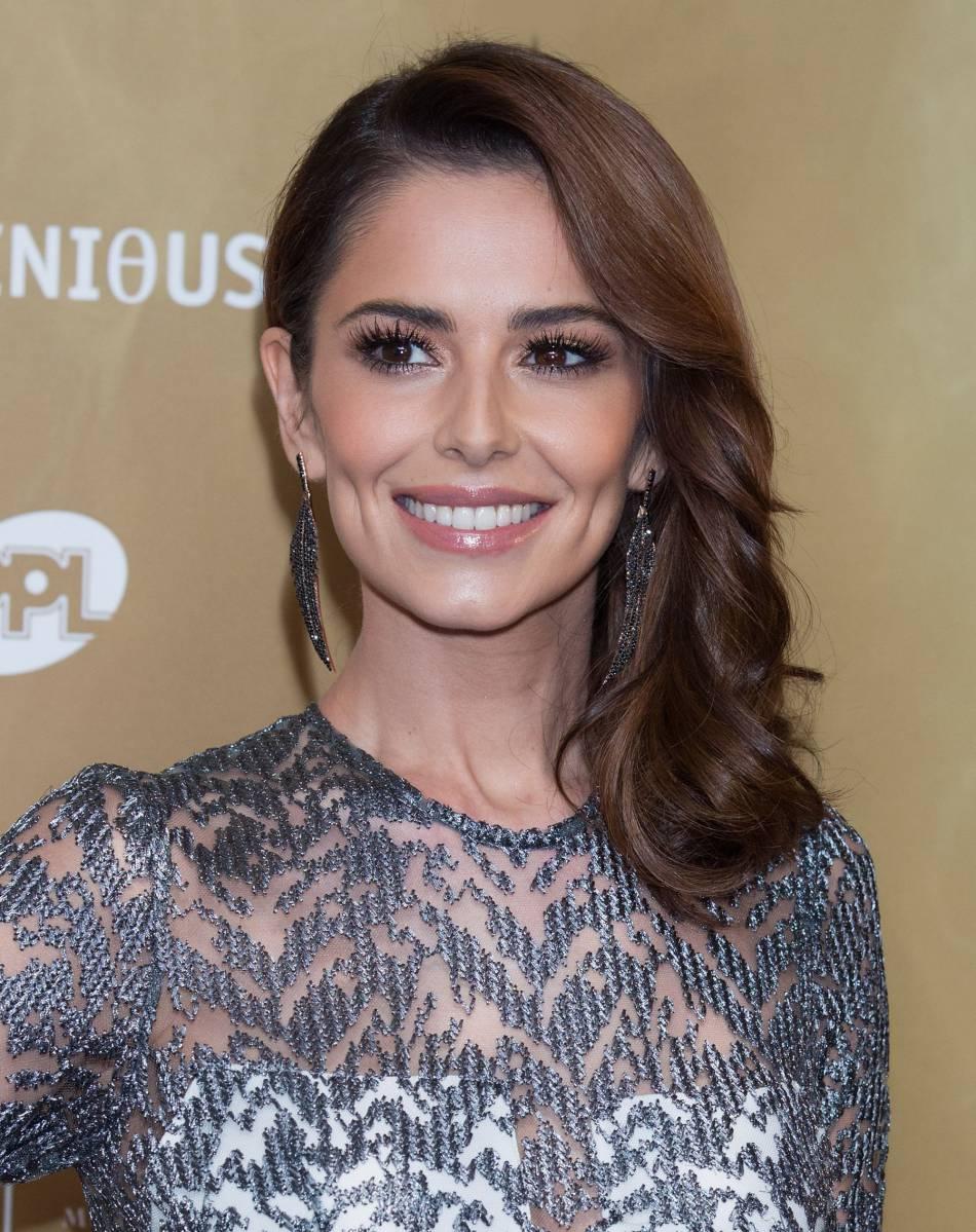 Cheryl Cole : un visage un peu creusé mais un sourire radieux.