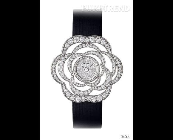 """Montre """"Fil de Camélia"""",     Chanel         Un grand classique dont on ne se lasse pas, le camélia de Chanel se décline aussi en montre.  Modèle en or blanc, boîte, pétales et boucle sertis diamants, cadran pavé diamants, bracelet en satin technologique noir."""