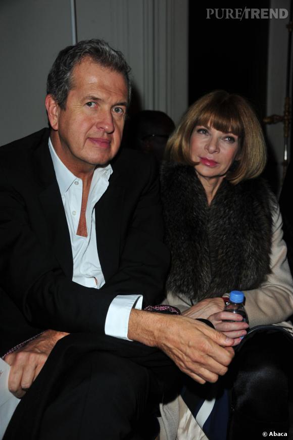 Mario Testino et Anna Wintour au défilé Yves Saint Laurent.