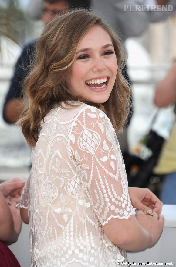 "Elizabeth Olsen, son photocall à Cannes pour le film ""Martha Marcy May Marlene""."
