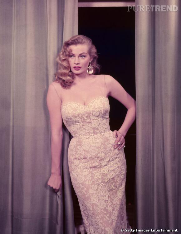 Comment on se coiffait dans les années 50 ?     Nom :  Anita Ekberg    Coiffure :  la chevelure est en mouvement, les longueurs s'ondulent, la mèche vient se plaquer sur le côté.