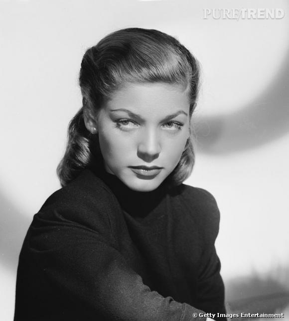 Comment on se coiffait dans les années 40 ?     Nom  : Lauren Bacall      Coiffure :  les cheveux tirés en arrière et la demi-queue ondulée.