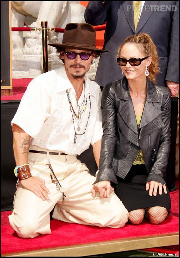 17 septembre 2005  : Après son étoile, ce sont ses empreintes que Johnny Depp immortalise. 6 ans après le Walk of Fame, le couple a l'air très amoureux.