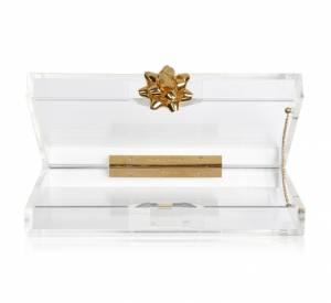 Must have : la collection Noël de Charlotte Olympia Minaudière Pandora Surprise!, environ 740 €