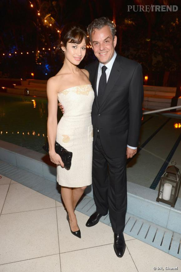 Olga Kurylenko  au dîner Chanel de l'Art Basel 2012 portait une robe de la collection Prêt-à-Porter Printemps-Eté 2013 ainsi qu'une pochette Chanel.