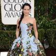 Lucy Liu s'offre un look de princesse en robe ultra bouffante imprimé fleuri Carolina Herrera.