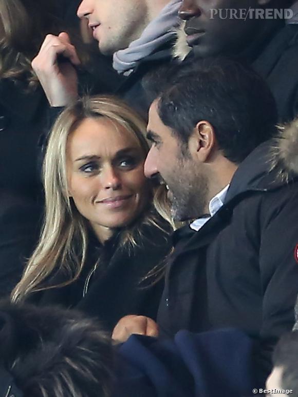Cécile de Ménibus et Ary Abittan lors d'un match du PSG.