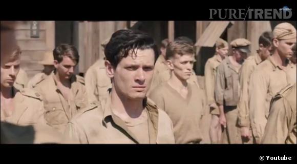 """Jack O'Connell incarne le rôle de Louis Zamperini dans le biopic """"Unbroken"""" réalisé par Angelina Jolie."""