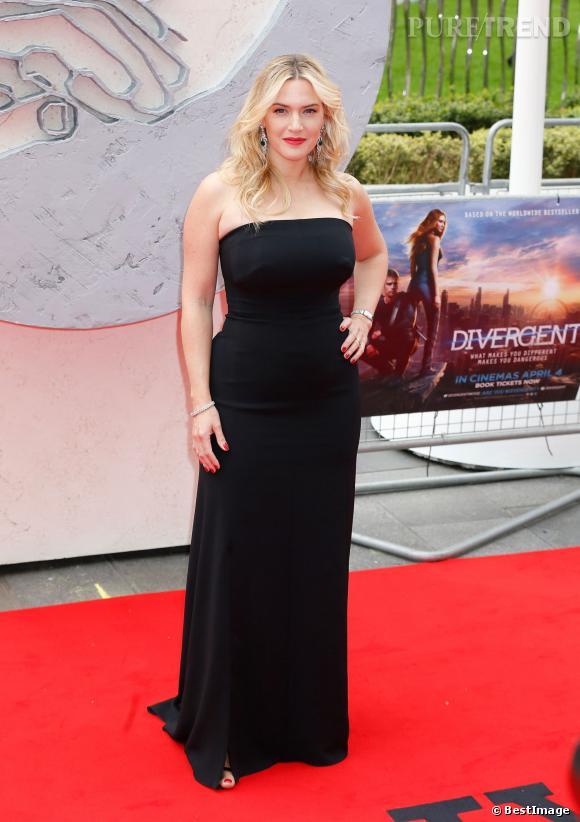 """Kate Winslet, courbes sublimées dans une robe noire bustier le 30 mars 2014 sur le tapis rouge de """"Divergent"""" à Londres."""
