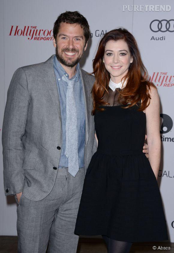 """Alyson Hannigan, ici aux côtés d'Alexis Denisof autre acteur de la série, vient de dire adieu à son personnage de Lily dans """"How I Met Your Mother""""."""