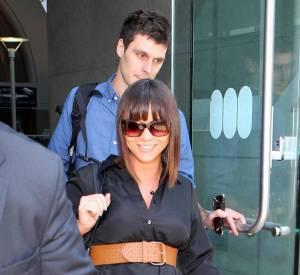 Christina Ricci, tout sourire vendredi à l'aéroport de Los Angeles. Difficile désormais de cacher sa grossesse.