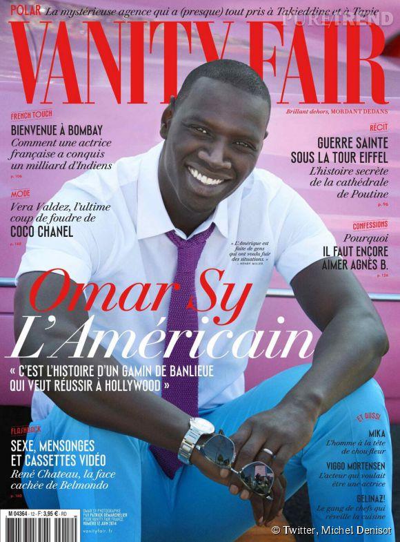 Omar Sy en chemisette blanche, cravate violette et pantalon turquoise pour  Vanity Fair .