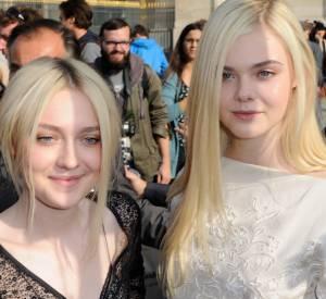 Dakota et Elle Fanning arrivent au défilé Louis Vuitton à Paris le 2 octobre 2013.