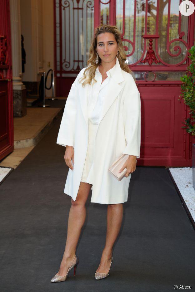 Vahina Giocante arrive à la présentation du parfum Untold d'Elizabeth Arden, jeudi 19 juin 2014 à Paris.