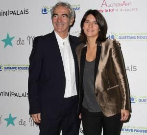 Raymond Domenech et Estelle Denis à Roland Garros en 2012.