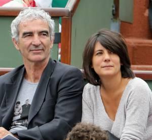 Raymond Domenech et Estelle Denis à Roland Garros à Roland Graros en 2012.