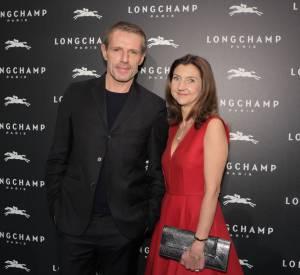 Lambert Wilson et Sophie Delafontaine à l'inauguration de la boutique Longchamp sur les Champs-Elysées le 4 décembre 2014.