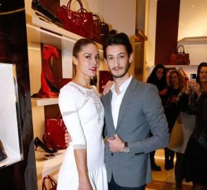 Pierre Niney et Natasha Andrews à l'inauguration de la boutique Longchamp sur les Champs-Elysées le 4 décembre 2014.