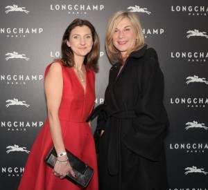 Sophie Delafontaine et Michèle Laroque à l'inauguration de la boutique Longchamp sur les Champs-Elysées le 4 décembre 2014.