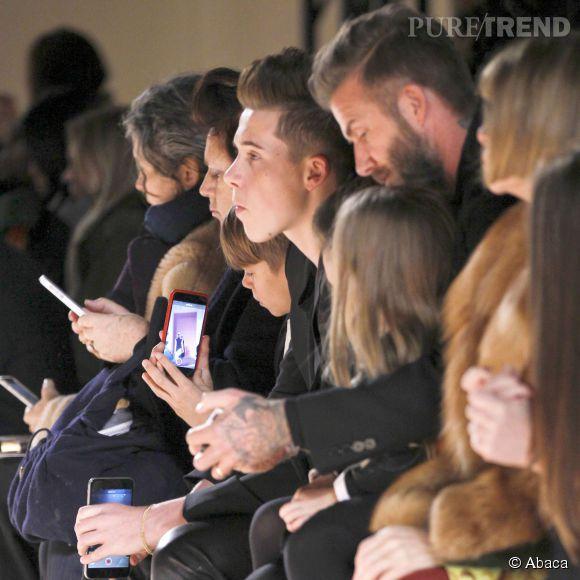 Les Beckham aux côtés d'Anna Wintour au défilé Victoria Beckham Automne-Hiver 2015/2016 à New York le 15 février 2015.