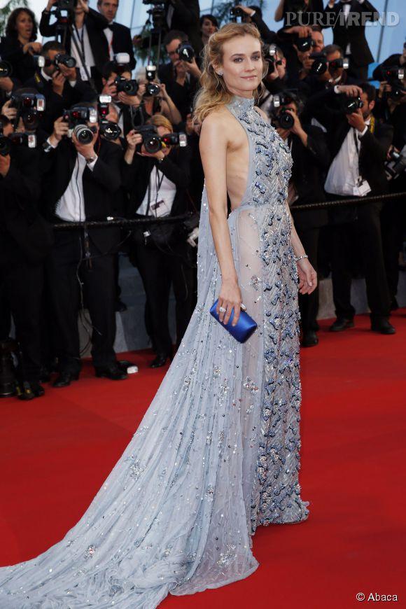 """Avec cette robe bleu pervanche brodée, des sandales """"Josie"""" signées Jimmy Choo et des signés bijoux Harry Winston, Diane Kruger était stupéfiante, samedi 16 mai 2015 au Festival de Cannes."""