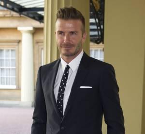 David Beckham, fier de poser à côté de la reine Elizabeth II