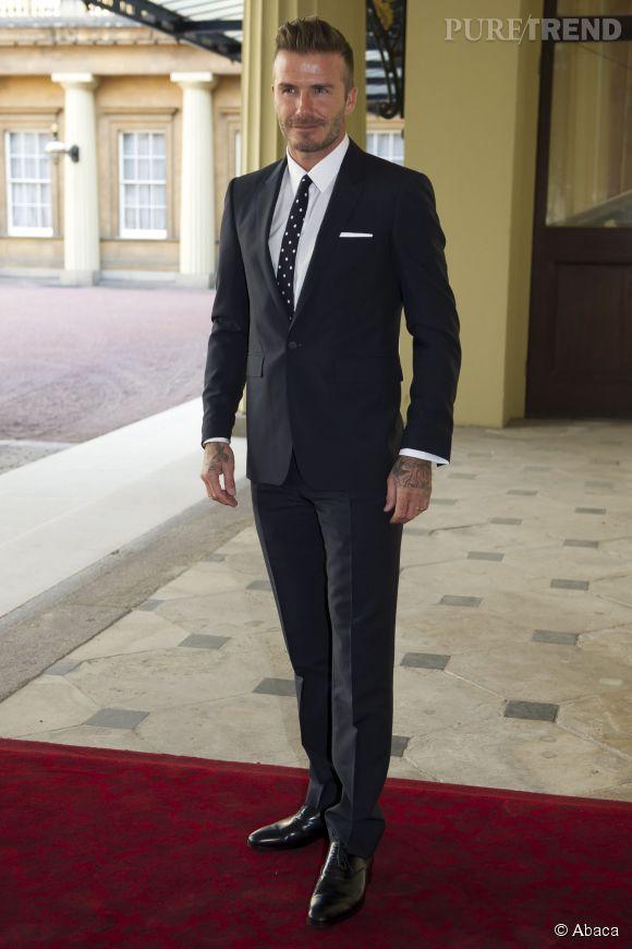 David Beckham a choisi un costume très classe pour se rendre à Buckingham Palace.