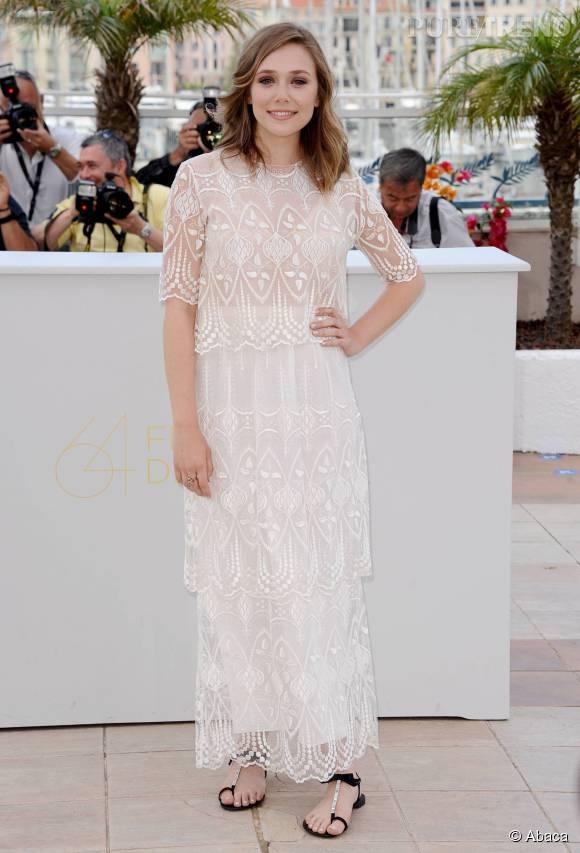 Sans conteste l'une des plus belles apparitions d'Elizabeth Olsen sur le tapis rouge (ainsi que l'une des premières), lors du Festival de Cannes 2011 dans une robe virginale signée The Row.